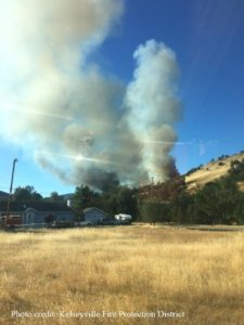 Photo of Pawnee Fire burning on a hill in Lake County