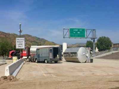 photo of simulated overturned tanker on section of highway at Del Valle