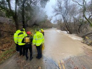 Water Rescue First Responders at Flooded Roadway