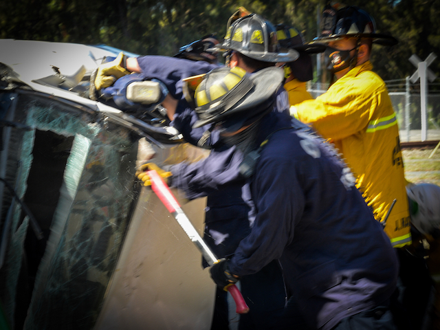 """Firefighters Work to Access """"Victim"""" through Car"""