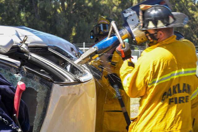 """Firefighter Works to Access """"Victim"""" through Car"""